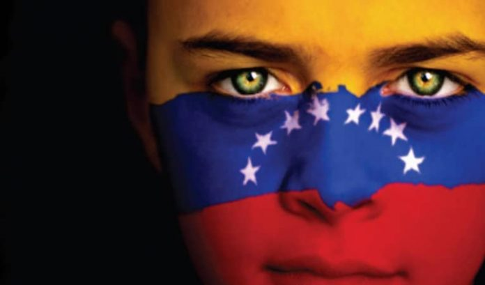 woman with a venezuelan flag painted on her face