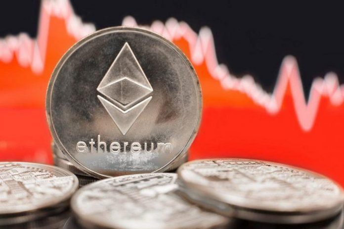 ethereum coin in front of a rising chart