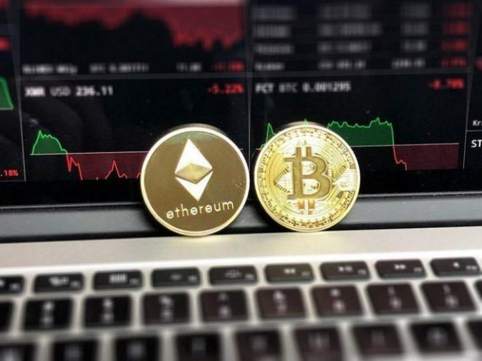 ethereum and bitcoin coins sitting on a computer