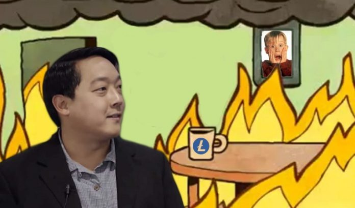 Charlie Lee in front of a burning house with a litecoin printed cup on a table