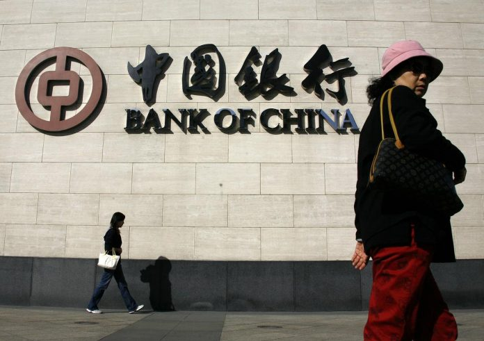 China central bank official says commercial banks should step up blockchain application