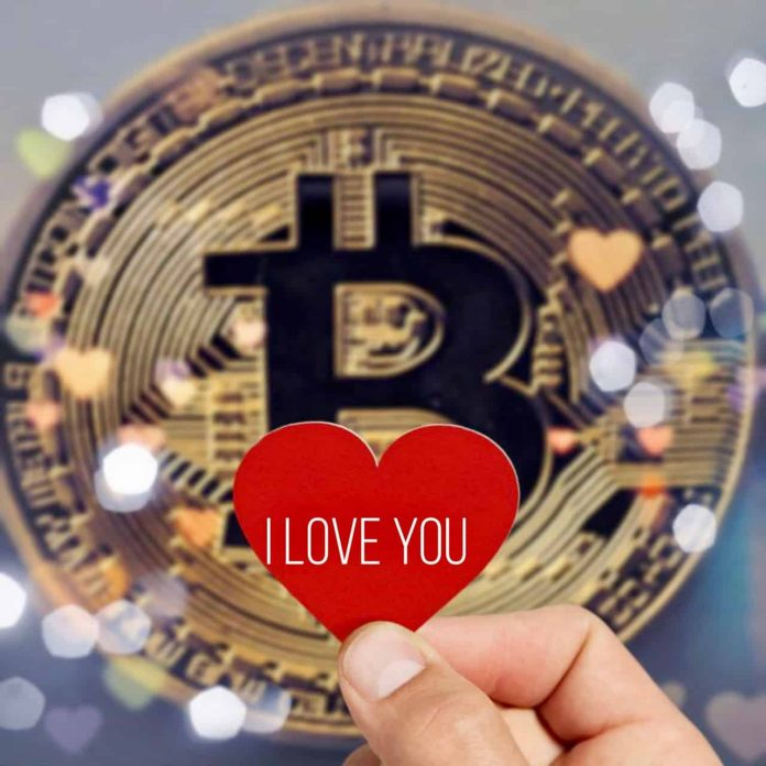 Bitcoin with a red heart in the middle
