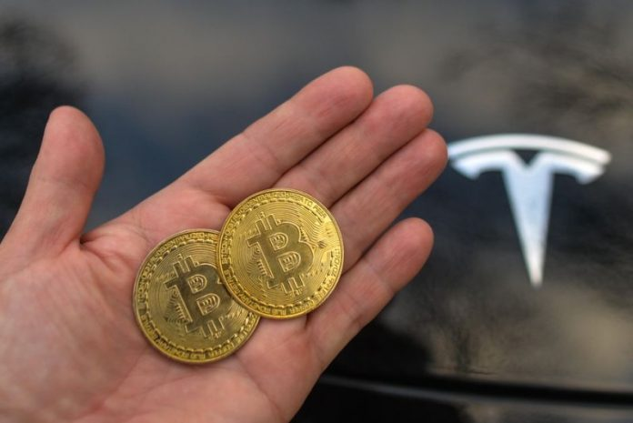 two bitcoins in a hand